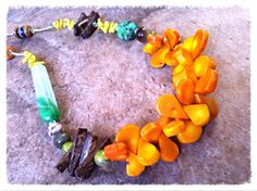Beautiful Coral pieces in a stunning setting of  gemstones and crystals. Made by TTTreasures.