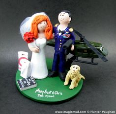 ....at Attention !!! Military Wedding Cake Toppers custom made for any soldier or marine of the Army, Navy, Air Force or any other outfit! Your wedding cake topper figurine can be in camo, dress blues, dress greens, or any combination of uniform or suit you desire. www.magicmud.com 1800 231 9814