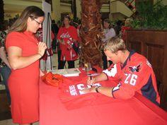Matt Hendricks signs autographs at the Scarlet Happy Hour event