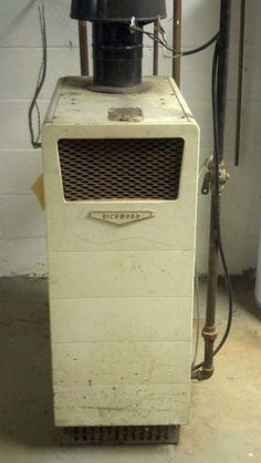 Old vintage natural gas boiler from the 50's.