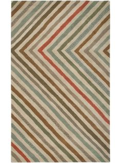 This Anna Redmond Collection pastel tone rug (AD2350) is manufactured by Rizzy Rugs. The process of making a rug is a beautiful dance that combines years of tradition, energy, innovation and skill, says artist and designer, Anna Redmond.