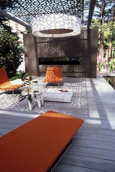08 modern bold pergola with laser cut metal screens to protect from the sun - Shelterness