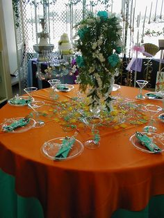 This table setting used Plastic Plates, Hard to believe it could look so upscale! Satin Table clothes were rented and the Tower Vases were used.