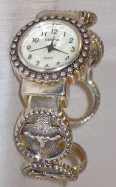 Ladies Geneva Elite Watch Quartz Silver-tone with Steers on Bangle Clamp Band.  Western watch  http://www.amazon.com/Ladies-Geneva-Quartz-Silver-tone-Steers/dp/B007V7OIQC/ref=sr_1_8?m=A2TYI3UBDWT8M3=merchant-items=UTF8=1358649710=1-8=watches#