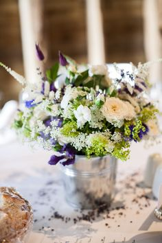 Pail of white and blue summer flowers by Foxgloves & Roses.