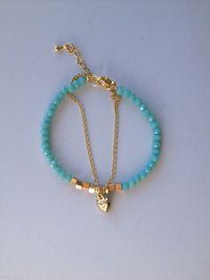 Blue crystal bracelet with a heart pendant Pulseira de cristal azul