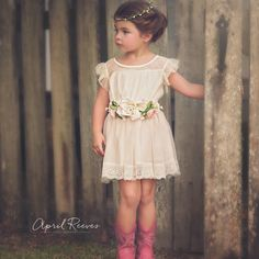 This gorgeous little dress is so comfy to wear for a formal event and also a casual outfit of the day.  The pretty silk flower sash is handmade and can also be worn in the hair for double the use!  Perfect for a little summer flower girl! Any dress purchased gets a free flower crown included!