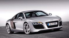 The Audi Sports Car makes Paris Motor Show Debut. Visitors to the 2006 Mondial de l'Automobile in Paris saw the debut of the 2008 Audi a breathtaking new aluminum-bodied, mid-engined sports car. Audi R8 Wallpaper, Sports Car Wallpaper, Hd Wallpaper, Audi Sports Car, Audi Cars, Sport Cars, Pictures Of Sports Cars, Car Pictures, Audi Sportwagen