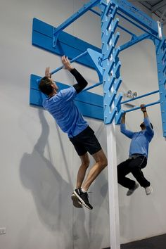 Dual height pull-up bars on MoveStrong Salmon Ladder to practice bounding and kipping to prepare for jumping up Salmon ladder