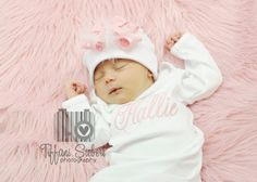 Bring home baby in an adorable monogrammed layette gown with matching double bow on a white hat with white feathers! If you prefer, the bow can be