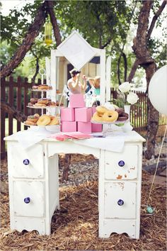 Such a great idea to have towers of boxes among cupcakes/donuts so that guests can take home goodies.