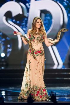 See the colorful costumes at the Miss Universe pageant! Miss Universe Costumes, Miss Universe National Costume, Miss Universe 2001, Miss Nigeria, Miss Great Britain, Miss Georgia, Miss Philippines, Pageant, Evening Gowns