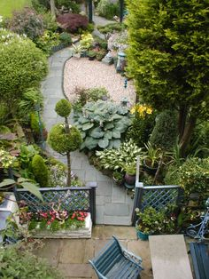 My garden is long but not narrow but nice ideas in this narrow garden design: Curved pathways add interest to a long narrow plot and also create the illusion of being much wider.  A curved path allows for differing vantage points to come into view at each twist and turn.