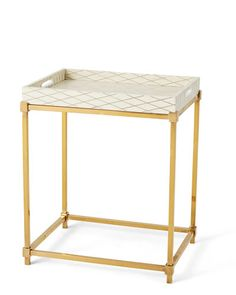 Bone-and-brass tray table by Scala Luxury.