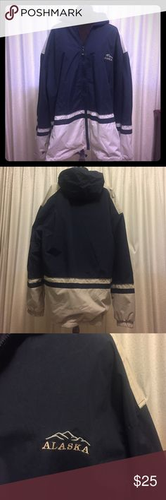 """NWOT: Navy Lightweight Jacket with Hood NWOT: Bought in Alaska, but never wore. Coat is navy blue and light tan. There is a silver reflective stripe between navy & tan section on arms & main body of coat. Men's Size 3XL. Chest has image of Alaskan Mountains and word """"Alaska"""" on front of coat. Soft plush inside and wind resistant to keep rain out.  Has 2 outside zip pockets. Shoulder width = 27"""", arm length = 26"""", length = 32"""" and chest = 58"""" around. Jackets & Coats"""