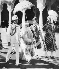 The Begum of Bhopal escorts Edward Prince of Wales ( Edward VIII/The Duke of Windsor) to the Durbar Hall, India, 1921. Hoping to break up his relationship with married mistress Freda Dudley Ward, his parents - George V & Queen Mary - decided to send him on a tour of India. It didn't work.....