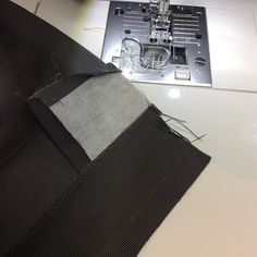Shot of waistband during construction.  Band is folded back and lining (petersham) is stitched along edge. #sewing #menwhosew