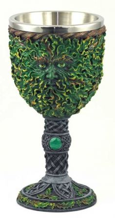 "Greenman Chalice 7 1/2"". Displaying the leafy visage of the Green Man, this chalice has been sculpted from cold cast resin to created an impressively detailed vessel for the altar. 7 1/2"" x 3 1/2"""