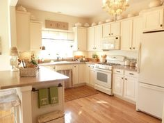 Kate's Place: The Kitchen:  White Country Style kitchen This whole house is amazing!