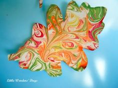 "Marbled Leaf Art:  The children at the preschool would love to make these marbled leaves.  Children love playing with shaving cream and food coloring to marbleize paper.  The children would use their creativity while making the paper and again while cutting out the leaf shapes.  These would be beautiful on the ""thankful tree.""  Very DAP."
