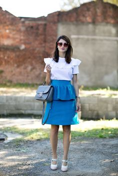 A blue ruffle skirt and a white ruffle blouse