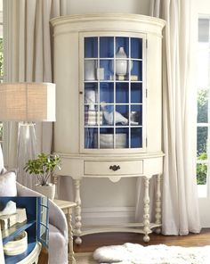 beautiful white cabinet with cobalt blue backing