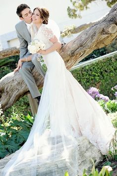 Gorgeous, modest lace wedding gown and a cathedral length veil! And a cute wedding pose! AlliChelle Photography » Utah Wedding Photographer | Southern California Wedding Photography