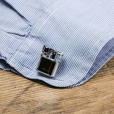 A pair of unassuming cufflinks that also happen to be lighters. | 26 Ridiculously Clever Products With A Secret