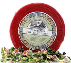 This traditional bandaged wrapped cheddar has a complex fruity flavor and a lingering floral finish. This cheese is made from the milk of cows that graze on lush spring and summer wild flower pastures.