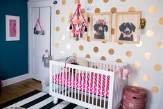 Fun, colorful nursery in teal, pink, black, and gold - accent wall - polka dots - nursery decor ideas and color palettes