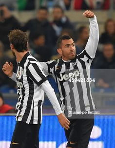Carlos Tevez of Juventus FC celebrates after...