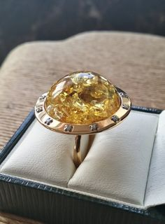 """Natural Baltic Amber ring with 18ct yellow gold original Rolex bezel with diamonds. 18ct yelow gold ring with amber. Amber and diamond ring,895$, by SebsJewellery *-Natural Baltic amber dimensions: diameter: 22mm (0.8in) x height: 11mm (0.4in)  -Diameter of the ring top part: 27mm (1in).   -Size of the ring is US 6, British """"L 1/2"""".  -Weight of the ring is 10 grams."""
