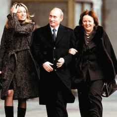 Maria Putin, the daughter of the Russian president, has reportedly fled Holland after calls for her to be deported following the downing of MH17. Pictured: Putin with his ex-wife and woman believed to be Maria