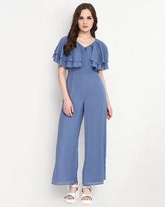 ,blue_jumpsuit ,ruffled_sleeves ,white_strappy_sandals ,contemporary_victorian_look ,loose_fit ,casual http://www.stalkbuylove.com/mykonos-jumpsuit-SBLPR.html