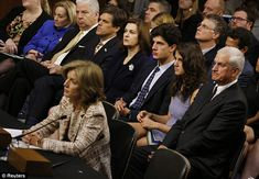 Caroline Kennedy (front) testifies. Also pictured are (2nd row): Widow of U.S. Senator Ted Kennedy, Victoria Reggie Kennedy (C), Caroline's son John (3rd R), Caroline's daughter Tatiana (2nd R) and husband Edwin Schlossberg Read more: http://www.dailymail.co.uk/news/article-2425554/Caroline-Kennedy-tells-Congress-humbled-carry-fathers-legacy-appointed-ambassador-Japan.html#ixzz2hA66Jfht Follow us: @MailOnline on Twitter | DailyMail on Facebook