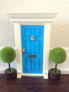 Light Blue Fairy Door by FairyAvenue on Etsy https://www.etsy.com/listing/194999272/light-blue-fairy-door