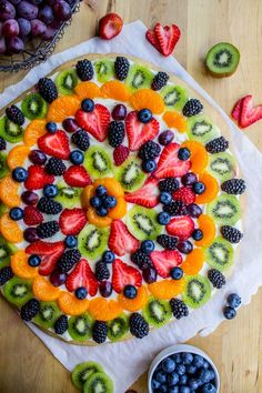 Beautiful desserts don't get much better than dessert pizza! Make a giant sugar cookie, slather it with cream cheese frosting, and then top it with fresh fruit. There's no summer dessert recipe that's more delicious or easy than this!