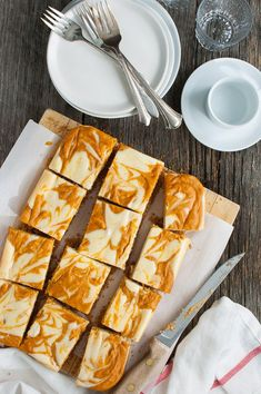 Marbled Pumpkin Cheesecake Bars - swirls of pumpkin and cheesecake with a graham cracker crust make for a perfect fall snackl. | tamingofthespoon.com