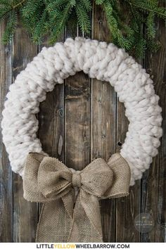 Make this rustic wreath in less than 30 minutes without any tools! We show you the quick step by step process to make a chunky knit wreath for your winter decorating. Add a bit of farmhouse charm to your holiday decorations. Crochet Wreath, Felt Wreath, Wreath Crafts, Diy Wreath, Door Wreaths, Tulle Wreath, Burlap Wreaths, Ribbon Wreaths, Wreath Ideas