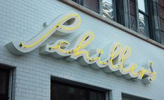 Schiller's neon sign – identity by Mucca / calligraphy by Nancy Howell