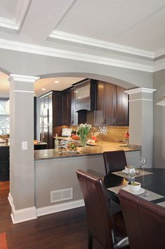 A wall between the kitchen and dining room was opened up, improving both spaces. #Housetrends #DiningRoomDecor #HomeDecor #KitchenRemodel