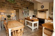 The gorgeous cottage kitchen in Egton - beautiful rustic style with flagstone flooring and chunky shabby chic furniture