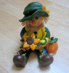 polymer clay ~ Scarecrow Holding Sunflower