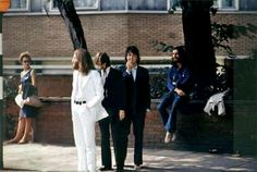 "The Beatles waiting to cross Abbey Road, 1969-""The front cover design of Abbey Road by the Beatles was taken on 8th August 1969. At around 11:30 that morning, photographer Iain Macmillan was given only ten minutes to take the photo whilst he stood on a step-ladder and a policeman held up the traffic"""