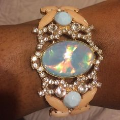 A BEAUTIFUL Statement Bracelet Hinged bracelet that has light pink & clear stones with two light blue stones & a big blue iridescent stone in the middle. ALDO Jewelry Bracelets