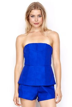 Laurel Blue Price: € 40.00  This playful WYLDR blue strapless playsuit is perfect for day & night.