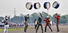 Indonesian Air Force Academy. Just... throwing drums.