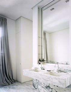 grey & white marble bathroom, design by Pierre Yovanovitch, white is carried throughout the apartment & here is contrasted with grey in the marble, the onyx floor & the large mirrors trimmed in chrome Grey Marble Bathroom, Diy Bathroom, Bathroom Toilets, Master Bathroom, Pierre Yovanovitch, Powder Room Design, Bathroom Interior Design, Bathroom Inspiration, Design Inspiration