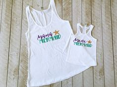 This mama mermaid and mini mermaid Tank Set is a perfect way to show off your summer style! This listing is for the set, but items can be sold individually. Send us a message for more information. Available in white and black. Mama tank is loose fitting swing style, so we recommend ordering a size down if you prefer a tighter fit. mini mermaid tank runs small in sizes 6M-5/6 so we recommend ordering a size up. Tank can be changed to a tee or bodysuit. Bodysuits are available starting wit...