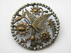 Antique brass metal button w/butterfly and cut steels